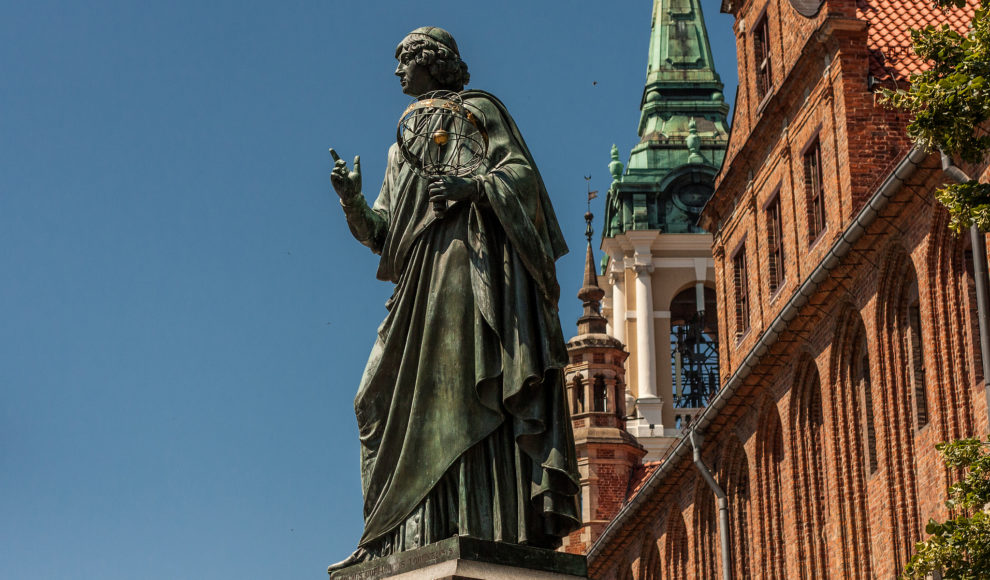 The Nicolaus Copernicus Monument in the astronomer's home town of Toruń, Poland. Copernicus, famous for developing a heliocentric model of the universe, was a devout Catholic.